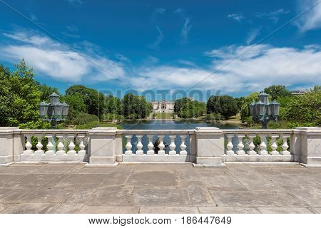 White balustrade overlooking the park near Wade Lagoon at summer, Cleveland Ohio. poster