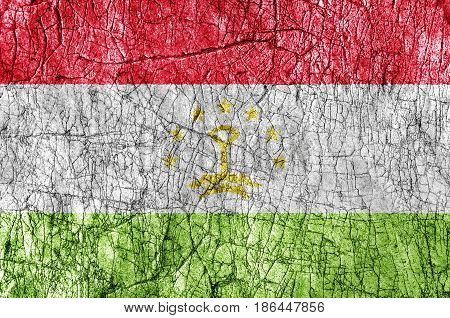 Grudge stone painted Tajikistan flag close up