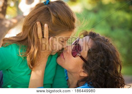 happy mather and daughter in summer