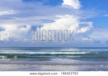 Sea view from tropical beach with sunny sky. Summer paradise beach with clouds on horizon. Ocean beach relax, outdoor travel