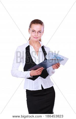A young woman standing in office with folder, isolated on white background.