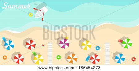 Top view of beach, sea, beach umbrellas and boats