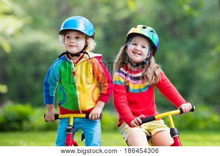 Kids Ride Balance Bike In Park