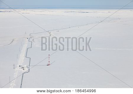 The route of the gas pipeline in Western Siberia in winter, view from above