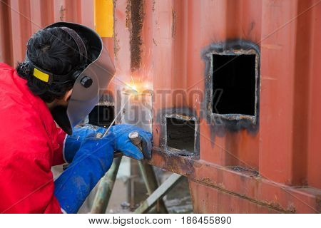 Worker repair container box by gas cutting and welding Job work worker heavy job hard job concept