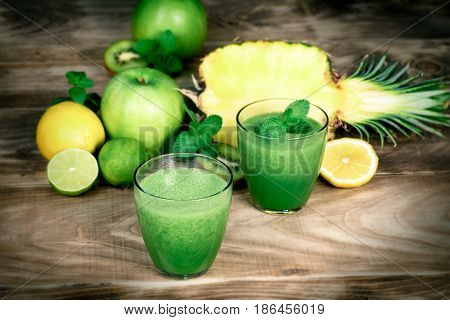 Green smoothie, healthy drink - made with fresh fruit and vegetables