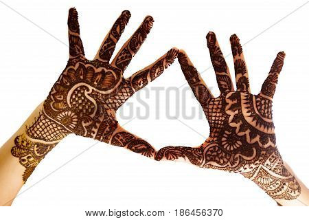 The hands together to show the beautiful Henna tattoo at the open hands and arms.