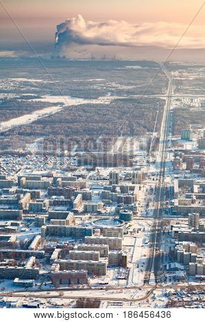 Tobolsk, Russia - February 08, 2017: Bird eye view onto modern part of town and pipes of power factory on background. Tyumen region