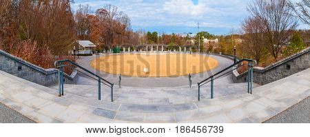 Panoramic view of oval lawn and Grand Arbor from stairs in the Piedmont Park in autumn day Atlanta USA