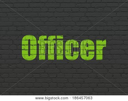 Law concept: Painted green text Officer on Black Brick wall background