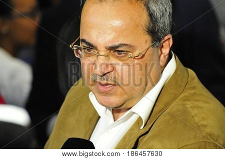 JERUSALEM, ISRAEL - June 10, 2014. Israeli Arab-Muslim politician Ahmad Tibi (Arab Movement for Change, the Joint List) commenting to the media during the presidential elections in the Israeli Knesset