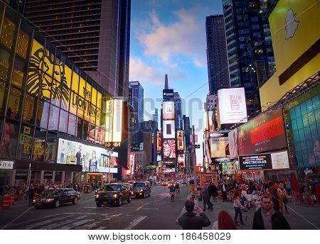 NEW YORK CITY, MANHATTAN, APR,24, 2015: Evening view on NYC Times Square lights screens buildings fashion boutiques led billboards skyscrapers architecture. Sightseeing holidays vacation tours trips