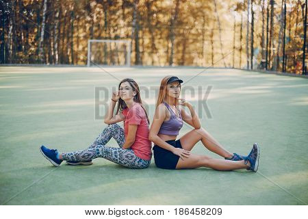 Sports girls involved in sports. run park. doing exercise on the playground. using communication