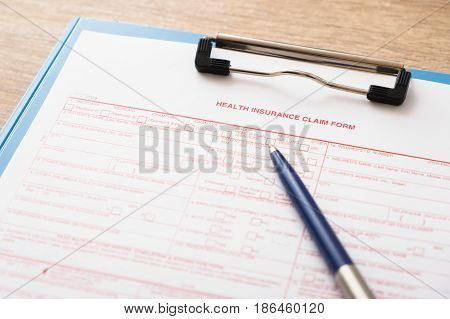 Health insurance claim form with a pen