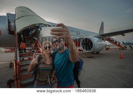 17 April 2017, Airoport HoChiMinh sity, VietNam. Modern young friends taking a selfie at international airport
