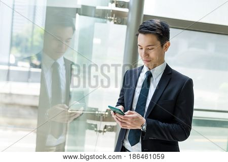 Businesman working on mobile phone