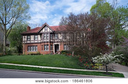 English Tudor Estate with Spring Landscaping