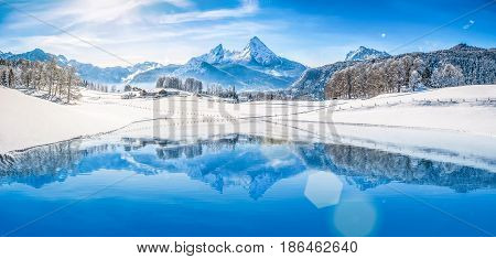 Winter Wonderland In The Alps Reflecting In Crystal Clear Mountain Lake