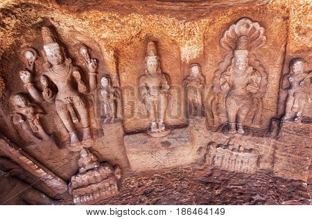 Lord Shiva and other Hindu gods in natural cave in Badami town, India. Temple carvings made in 6th century now Karnataka state