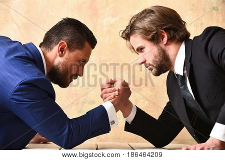 Arm Wrestling Of Businessman And Compete Man