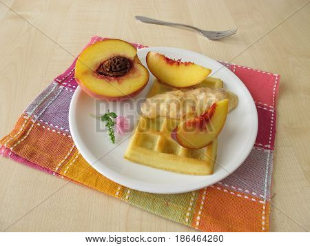 Homemade waffles with peach yogurt cream and fresh fruits