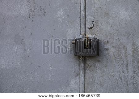 Old Rusty Door With A Lock