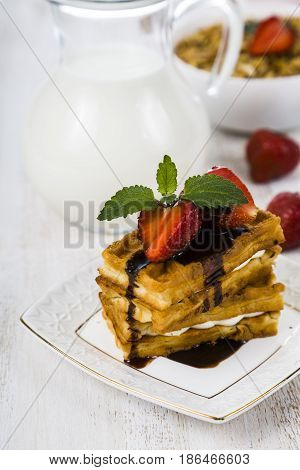 Delicious Waffle With Berries And A Jug Of Milk On Wooden Table.