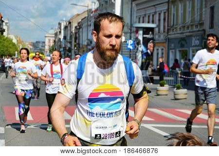 CLUJ-NAPOCA ROMANIA - May 14 2017: People of all ages families with kids run on the streets at the Color Run course