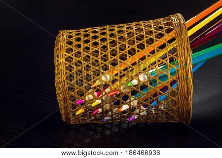 Colored Pencils Are Visible Through A Wicker Glass