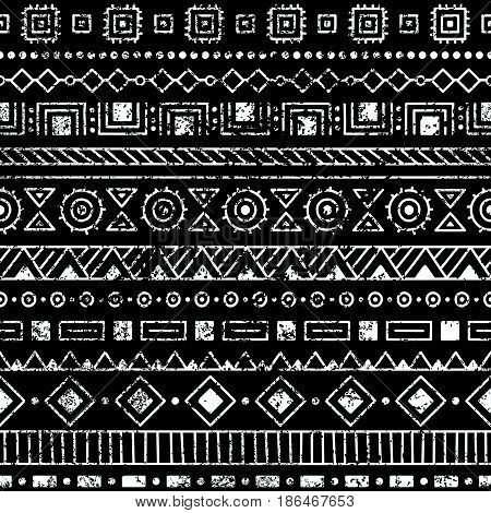 Seamless ethnic pattern. Tribal and aztec motifs. Grunge texture. Black and white vintage print. Vector illustration.