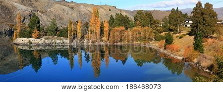 panoram reflection of southern alpine alps mountain range as a Mirror at lake Lake Dunstan cromwell in New Zealand