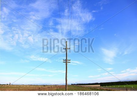 electric power post with sunny sky