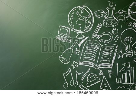 Drawn symbols of school subjects on a chalkboard, copy space