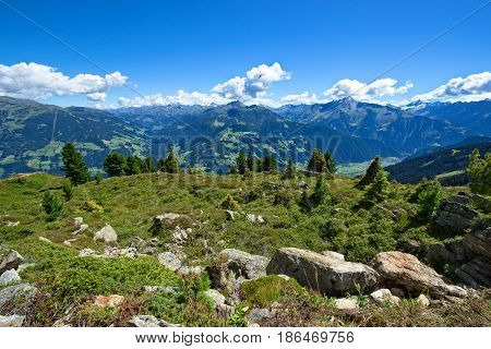 Amazing summer mountain landscape with green meadow and stones in the foreground. Austria Tirol Zillertal Zillertal High Alpine Road