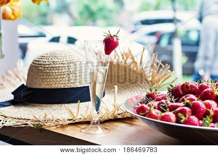 Dish With Strawberries And Champagne Glasses On The Table.