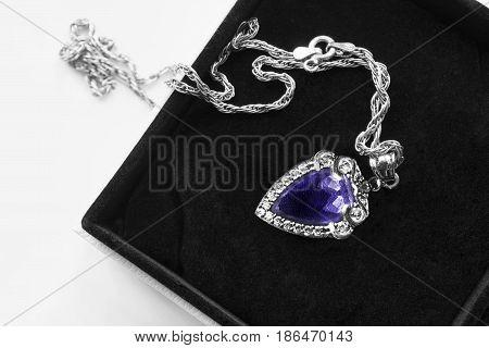 Vintage amethyst pendant on silver chain in black jewel box