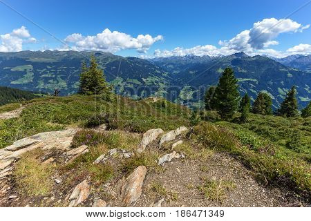 High mountain scenery with blue cloudy sky and stones in the foreground. Austria Tirol Zillertal Zillertal High Alpine Road Zillertaler Hoehenstrasse