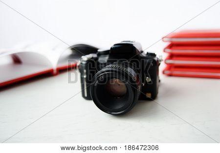 the camera on the background of photo books. graduation photo.