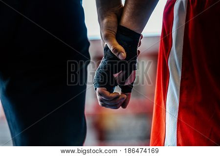close-up hand boxer and referee winner announced in boxing fight