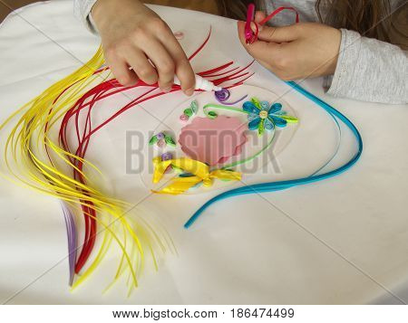 Decorate With Strips Of Paper, Quilling .hands Child While Creative Work Making Decorations Paper