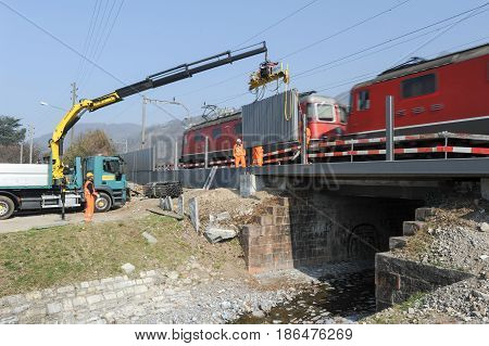 Workers During The Installation Of Noise Barriers On The Railway