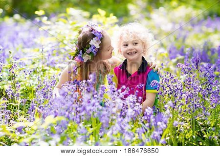 Kids With Bluebell Flowers, Garden Tools