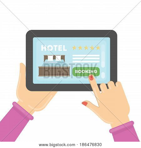 Online hotel booking. Female hands typing on tablet to book a room in the hotel.