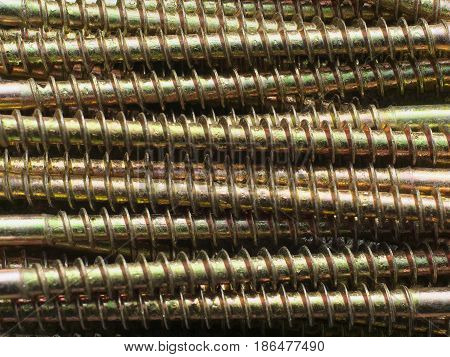 closeup industrial Background with gold metall screw.
