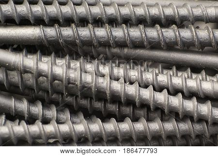 industrial Background with the black metall spiral screw.