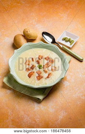 potatoes soup with roasted salmon and wasabi