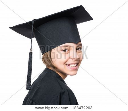 Portrait of a graduate little girl student in a black graduation gown with hat, close up - isolated on white background. Child back to school and educational concept.