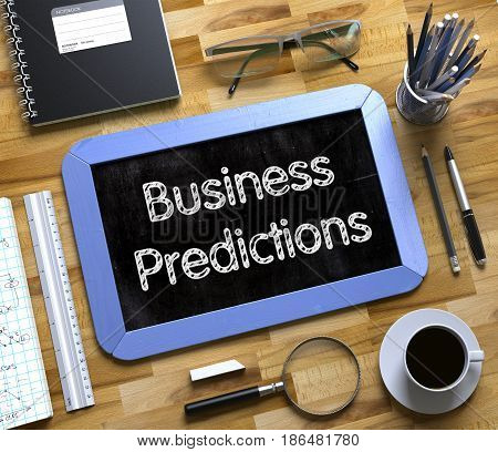Small Chalkboard with Business Predictions. Top View of Office Desk with Stationery and Blue Small Chalkboard with Business Concept - Business Predictions. 3d Rendering.