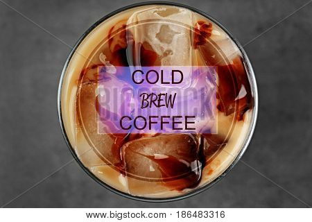 Glass of cold brewed coffee with milk, closeup
