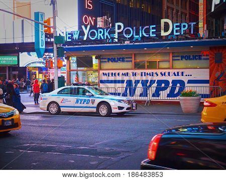 NEW YORK TIMES SQUARE, APR,24, 2015: Post of NYPD New York Police Department on Times Square among people and tourists. Police car. NYCPD NYC police. Police cops car